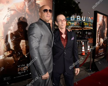 """Actor Vin Diesel, left, and director David Twohy arrive on the red carpet at the world premiere of the feature film """"Riddick"""" at the Regency Village Theatre on in Los Angeles"""