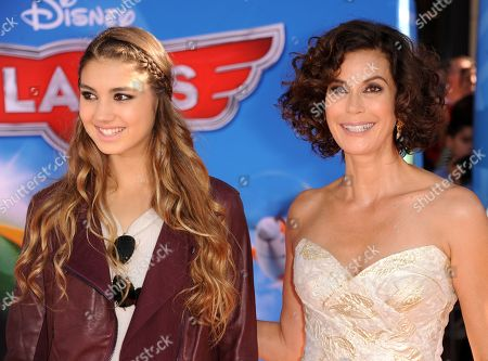 """Emerson Tenney, left, and Teri Hatcher arrive at the world premiere of """"Disney's Planes"""" at the El Capitan Theatre on in Los Angeles"""