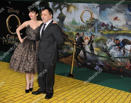 """Sam Raimi, right, and Gillian Greene arrive at the world premiere of """"Oz The Great and Powerful"""" at the El Capitan Theatre on in Los Angeles"""