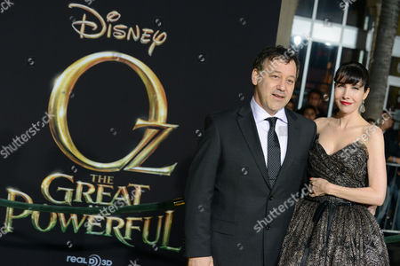 """Sam Raimi, left, and Gillian Greene arrive at the world premiere of """"Oz The Great and Powerful"""" at the El Capitan Theatre on in Los Angeles"""