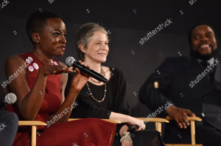 """Danai Gurira, and from left, Melissa McBride and Chad Coleman are seen at """"The Walking Dead"""" ATAS FYC event at the Egyptian Theater on in Los Angeles"""