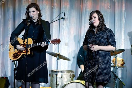 "The Secret Sisters, Lydia Rogers, left, and Laura Rogers, right, perform at the UCLA's Jonsson Cancer Center Foundation 18th Annual ""Taste for a Cure"" event at The Beverly Wilshire Hotel on in Los Angeles"