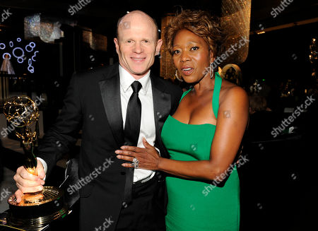 LOS ANGELES, CA - SEPTEMBER 10: (L-R) Paul McCrane and Alfre Woodard attends the 2011 Academy of Television Arts & Sciences Primetime Creative Arts Emmy Awards Governors Ball at the Los Angeles Convention Center on in Los Angeles, California