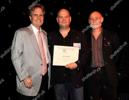 NORTH HOLLYWOOD, CA - SEPTEMBER 8: (L-R) Dan Foliart, President, the Society of Composers and Lyricists, Emmy nominee Trevor Morris, and Television Academy Governor Mark Adler pose at the 2011 Academy of Television Arts and Sciences Music Nominee Reception held at the Academy of Television Arts & Sciences in North Hollywood, California, Thursday September, 8 2011