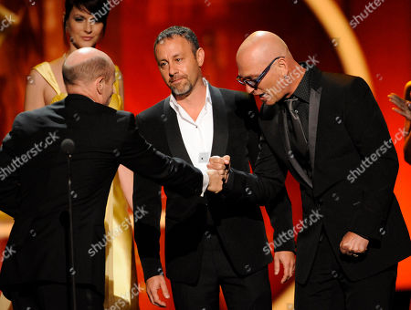 "LOS ANGELES, CA - SEPTEMBER 10: (L-R) Paul McCrane accepts the award for ""Outstanding Guest Actor in a Drama Series"" from Jason Raff and Howie Mandel onstage at the Academy of Television Arts & Sciences 2011 Primetime Creative Arts Emmy Awards at the Nokia Theater L.A. Live on in Los Angeles, California"