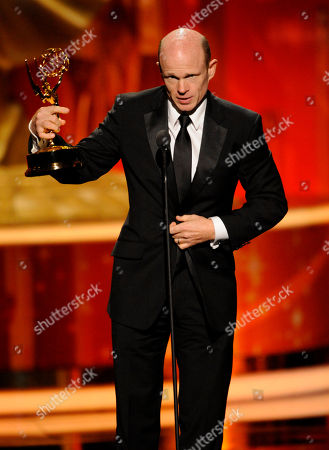"""LOS ANGELES, CA - SEPTEMBER 10: Paul McCrane accepts the award for """"Outstanding Guest Actor in a Drama Series"""" onstage at the Academy of Television Arts & Sciences 2011 Primetime Creative Arts Emmy Awards at the Nokia Theater L.A. Live on in Los Angeles, California"""