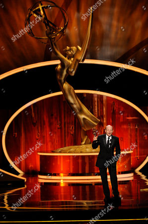 "LOS ANGELES, CA - SEPTEMBER 10: Paul McCrane accepts the award for ""Outstanding Guest Actor in a Drama Series"" onstage at the Academy of Television Arts & Sciences 2011 Primetime Creative Arts Emmy Awards at the Nokia Theater L.A. Live on in Los Angeles, California"