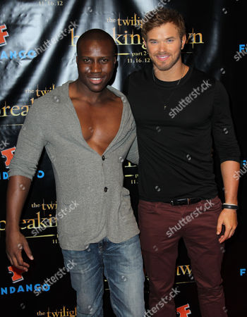 """Kellan Lutz, right, and Amadou Ly pose together at Summit Entertainment's """"The Twilight Saga: Breaking Dawn - Part 2"""" VIP Comic-Con celebration, in San Diego"""