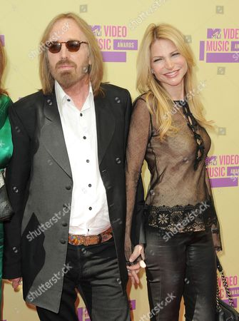 Singer Tom Petty and his wife Dana York arrive at the MTV Video Music Awards, in Los Angeles