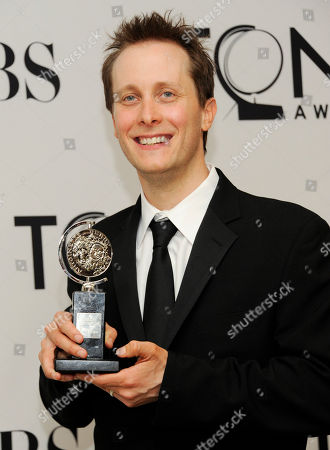 Stock Picture of Jeff Croiter poses with Tony at the 66th Annual Tony Awards, in New York