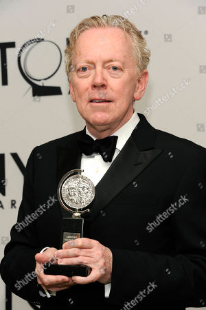 Bob Crowley poses backstage with his award at the 66th annual Tony Awards, in New York