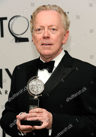 Bob Crowley winner for Best Scenic Design of a Musical fro 'Once' poses at the 66th Annual Tony Awards, in New York