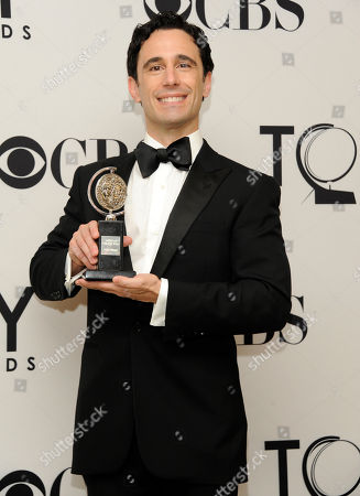Christopher Gattelli poses with is Tony at the 66th Annual Tony Awards, in New York