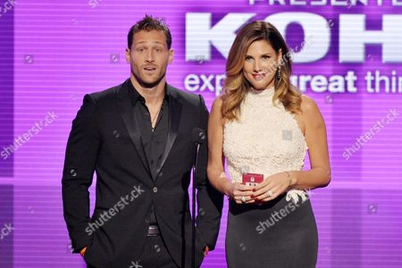 Juan Pablo Galavis, left, and Daisy Fuentes present the award for new artist of the year at the American Music Awards at the Nokia Theatre L.A. Live, in Los Angeles
