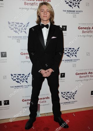 Lou Wegner arrives at the 2013 Genesis Awards Benefit Gala at The Beverly Hilton on in Los Angeles