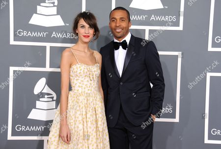 Stock Photo of Alexa Chung, left, and Matte Babel arrive at the 55th annual Grammy Awards, in Los Angeles