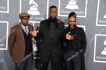 From left, Chris Dave, Robert Glasper and Casey Bengamin arrive at the 55th annual Grammy Awards, in Los Angeles