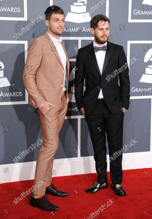 Foster the People, Cubbie Fink, left, and Mark Foster arrive at the 55th annual Grammy Awards, in Los Angeles