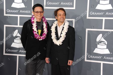 Stock Image of Ken Yang, left, and Daniel Ho arrive at the 55th annual Grammy Awards, in Los Angeles