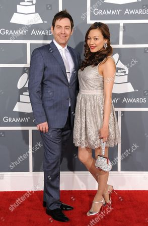 Photek, left, and Stephanie Chao arrive at the 55th annual Grammy Awards, in Los Angeles