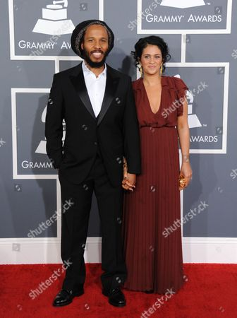 Ziggy Marley, left, and Orly Marley arrive at the 55th annual Grammy Awards, in Los Angeles