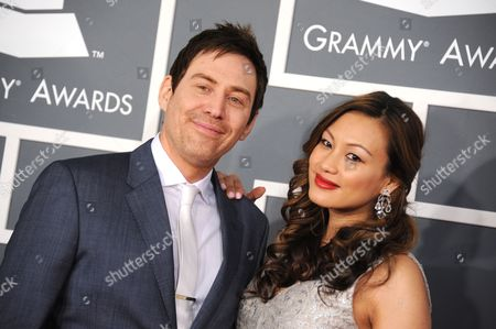Stock Picture of Photek, left, and Stephanie Chao arrive at the 55th annual Grammy Awards, in Los Angeles