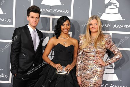 From left, John Thomas, Jade Novah and Beaux Sanders, of Hit Lab Group, arrive at the 55th annual Grammy Awards, in Los Angeles