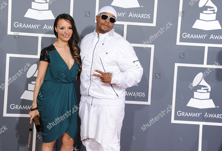 Musician Malik Yusef, left and guest arrive at the 55th annual Grammy Awards, in Los Angeles