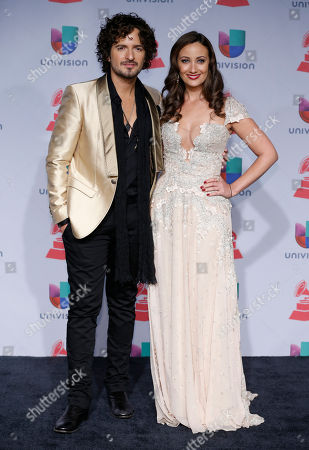 Tommy Torres left, and Karla Monroig arrive at the 14th Annual Latin Grammy Awards at the Mandalay Bay Hotel and Casino, in Las Vegas