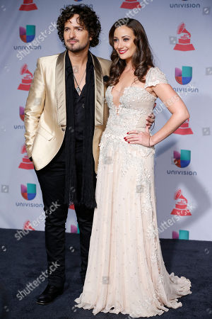 Tommy Torres, left, and Karla Monroig arrive at the 14th Annual Latin Grammy Awards at the Mandalay Bay Hotel and Casino, in Las Vegas