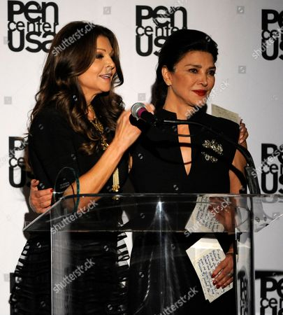 Actress Shohreh Aghdashloo, right, presents the freedom to write award to Sonia Nassery Cole at the 23rd Annual Literary Awards at The Beverly Hills Hotel, in Beverly Hills, Calif