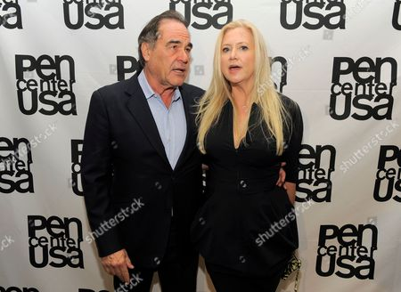 Director Oliver Stone, left, and producer Laura Bickford attend the 23rd Annual Literary Awards at The Beverly Hills Hotel, in Beverly Hills, Calif