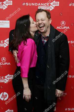 """Director, writer and producer Liz Garcia, left, kisses her husband and cast member Joshua Harto, right, as they pose together at the premiere of """"The Lifeguard"""" during the 2013 Sundance Film Festival on in Park City, Utah"""