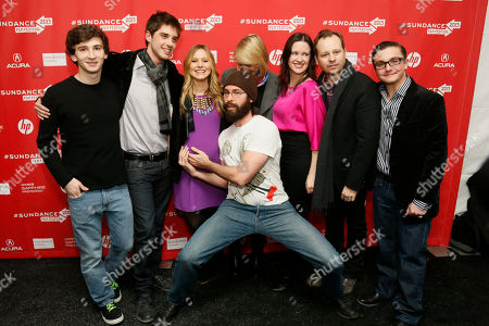 """Cast member Martin Starr, center front, holds the pregnant belly of Kristen Bell, while, form left to right, Alex Shaffer, David Lambert, Mamie Gummer, director and writer Liz Garcia, Joshua Harto, and Paulie Litt also pose together at the premiere of """"The Lifeguard"""" during the 2013 Sundance Film Festival on in Park City, Utah"""