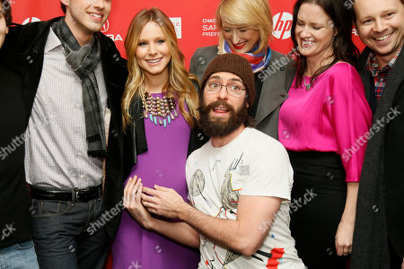 """Cast member Martin Starr holds the pregnant belly of Kristen Bell, left, while Mamie Gummer, top, and director and writer Liz Garcia laughs while they pose together at the premiere of """"The Lifeguard"""" during the 2013 Sundance Film Festival on in Park City, Utah"""