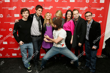 "Cast member Martin Starr, center front, holds the pregnant belly of Kristen Bell, while, form left to right, Alex Shaffer, David Lambert, Mamie Gummer, director and writer Liz Garcia, Joshua Harto, and Paulie Litt also pose together at the premiere of ""The Lifeguard"" during the 2013 Sundance Film Festival on in Park City, Utah"