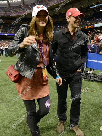 Actress/singer Katherine McPhee, left, and guest are seen at Super Bowl XLVII on in New Orleans