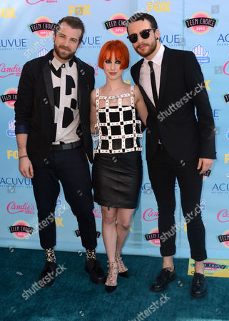 From left, Jeremy Davis, Hayley Williams and Taylor York of the musical group Paramore arrive at the Teen Choice Awards at the Gibson Amphitheater, in Los Angeles