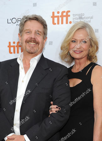 """John Wells, left, and Marilyn Wells arrive at the premiere of """"August: Osage County"""" on day 5 of the Toronto International Film Festival at the Roy Thomson Hall, in Toronto"""