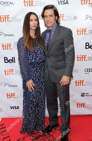 """Dermot Mulroney, right, and Tharita Catulle arrive at the premiere of """"August: Osage County"""" on day 5 of the Toronto International Film Festival at the Roy Thomson Hall, in Toronto"""