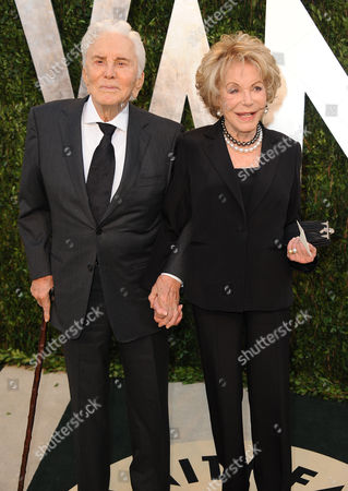 From left, actor Kirk Douglas and Anne Buydens arrive at the 2013 Vanity Fair Oscars Viewing and After Party on at the Sunset Plaza Hotel in West Hollywood, Calif