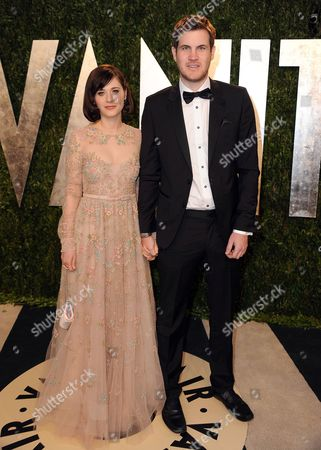 From left, actress Zooey Deschanel and writer Jamie Linden arrive at the 2013 Vanity Fair Oscars Viewing and After Party on at the Sunset Plaza Hotel in West Hollywood, Calif