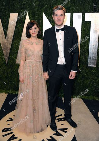 Actress Zooey Deschanel and writer Jamie Linden arrive at the 2013 Vanity Fair Oscars Viewing and After Party on at the Sunset Plaza Hotel in West Hollywood, Calif