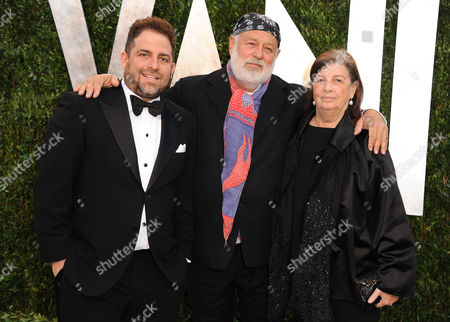 From left, producer Brett Ratner, photographer Bruce Weber and Nan Bush arrive at the 2013 Vanity Fair Oscars Viewing and After Party on at the Sunset Plaza Hotel in West Hollywood, Calif