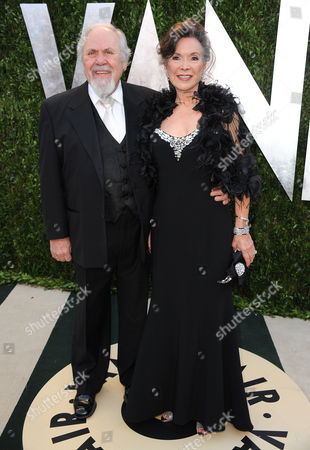 From left, producer George Schlatter and wife Jolene Brand arrive at the 2013 Vanity Fair Oscars Viewing and After Party on at the Sunset Plaza Hotel in West Hollywood, Calif