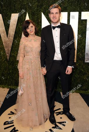 Stock Image of From left, actress Zooey Deschanel and writer Jamie Linden arrive at the 2013 Vanity Fair Oscars Viewing and After Party on at the Sunset Plaza Hotel in West Hollywood, Calif