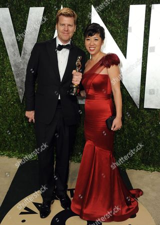 From left, animator John Kahrs and guest arrive at the 2013 Vanity Fair Oscars Viewing and After Party on at the Sunset Plaza Hotel in West Hollywood, Calif