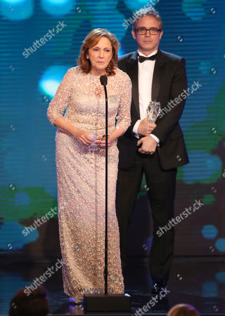 Ann Druyan and Brannon Braga accept the Best Reality Series award for 'Cosmos: A Spacetime Odyssey' at the Critics' Choice Television Awards at the Beverly Hilton Hotel, in Beverly Hills, Calif