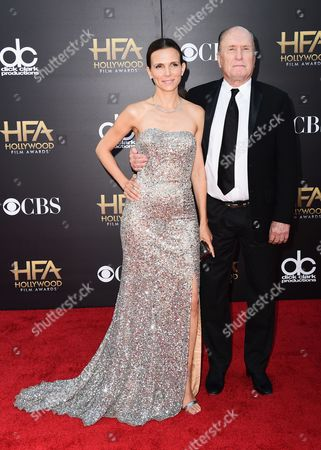 Luciana Pedraza, left, and Robert Duvall arrive at the Hollywood Film Awards at the Palladium, in Los Angeles