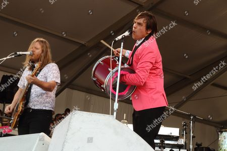 Tim Kingsbury (L), and Jeremy Gara, of Arcade Fire performs at the 2014 New Orleans Jazz & Heritage Festival at Fair Grounds Race Course, in New Orleans